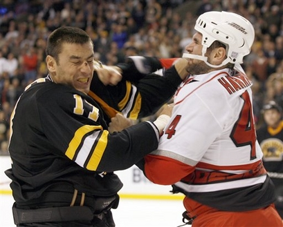 Jay Harrison, seen here fighting Milan Lucic, is now a member of the Winnipeg Jets.  (Picture courtesy of yahoo.com)