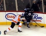 Andrew Ladd fights off check Feb 21 2012