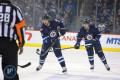 Stafford with puck, Scheifele following up