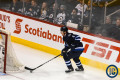 Trouba behind the net with puck